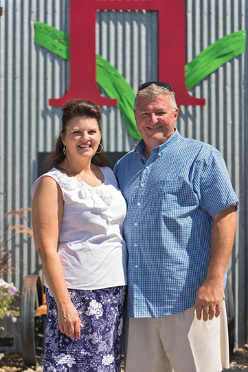 Gregg and Mary Alger standing in front of the Huston Vineyards tasting room