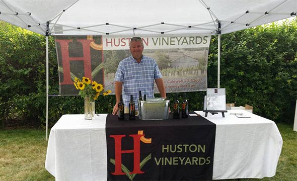 Gregg Alger at a Huston Vineyards booth at a community event