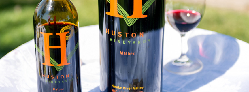 Huston Vineyards Malbec wine bottles with wine glass