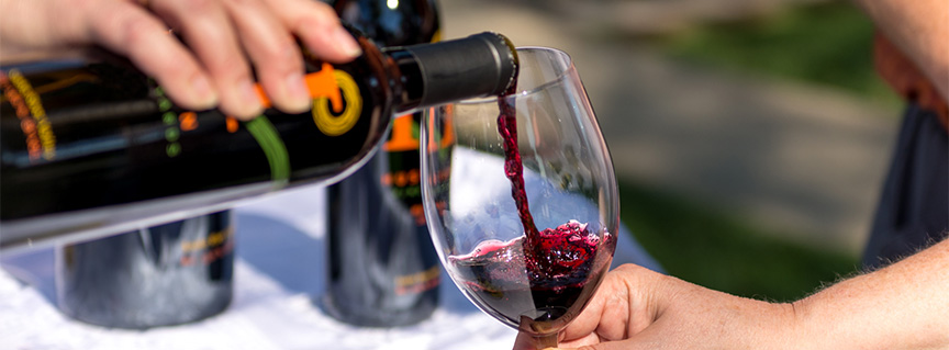 Huston Vineyards Merlot wine pouring into glass